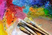 oil paints and paint brushes on a palette