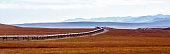 Oil Pipeline cutting across the tundra of Alaska