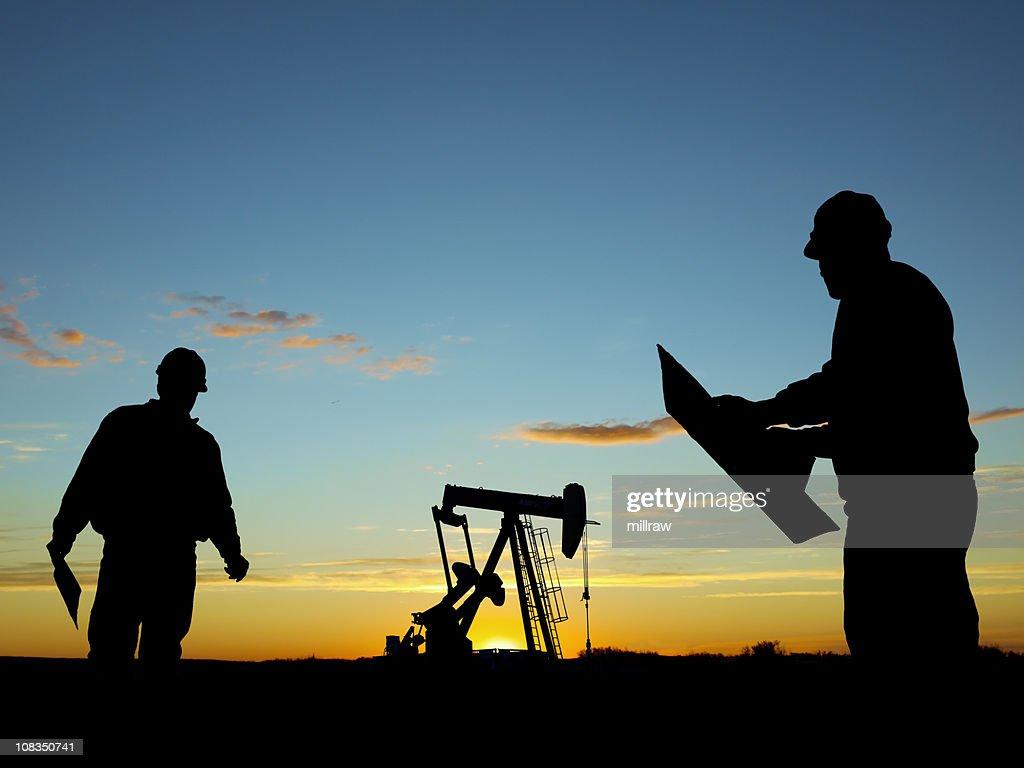 Oil Pump Pumpjack & Worker Silhouettes