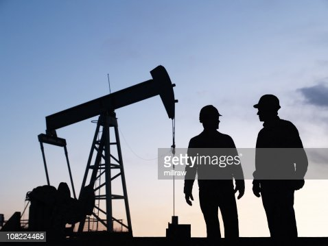 Oil Pump Pumpjack & Worker Silhouettes : Stock Photo