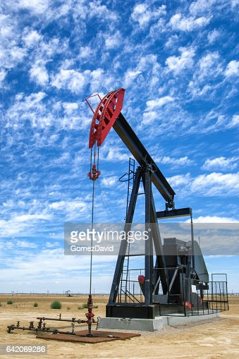 Oil Pumpjack with Clouds in Background : Stock Photo