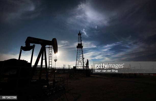 Oil pumps and drilling equipment in an oil field in Kern County where the majority of California's oil and gas production is centered A year's worth...