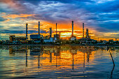 oil refinery at twilight and water reflection , Chao Phraya river, Thailand
