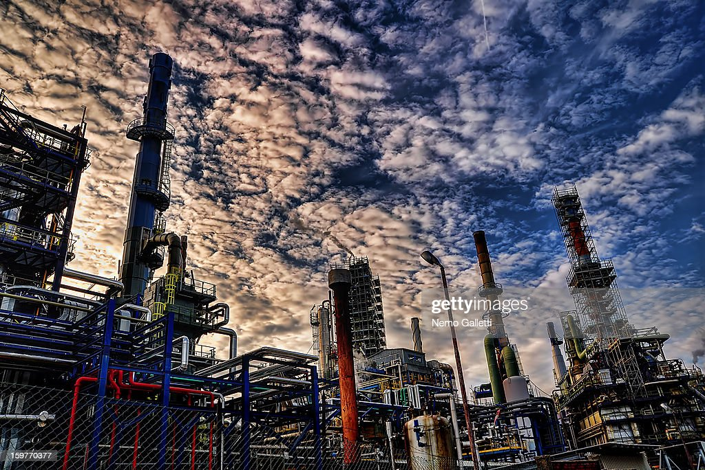 CONTENT] Oil Refinery, Busalla, Genova, Italy. Petrochemical plant. Distillation towers. Pipes, tubes, chemicals, diesel, gasoil, oil, pollution, energy. IPLOM S.p.A.