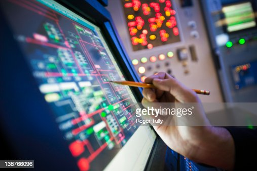 Oil refinery control room screen : Stock Photo