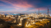 Oil refinery factory with beautiful sky at dusk for energy or gas industry or transportation background.