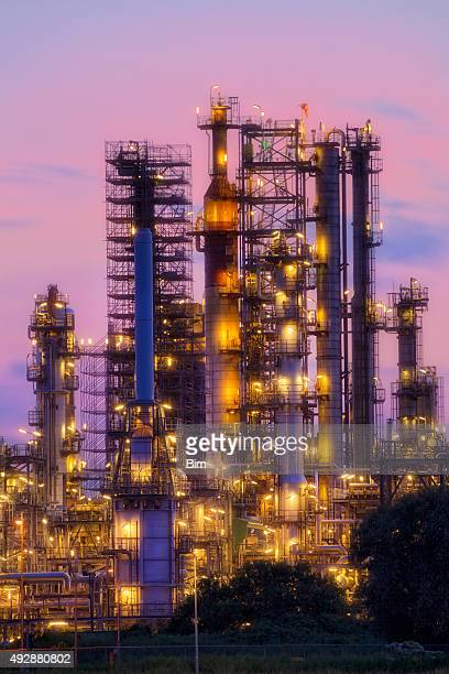 Oil Refinery Illuminated At Twilight