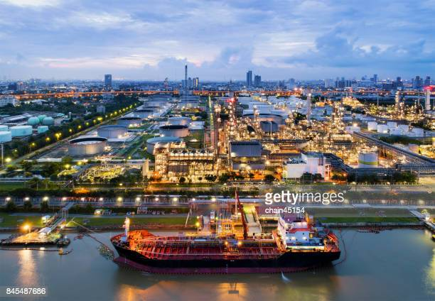 Oil refinery industry plant from aerial view in oil refinery industry or oil industrial. This oil refinery is in the city for refinery producing of oil and gasoline. Industrial concept.