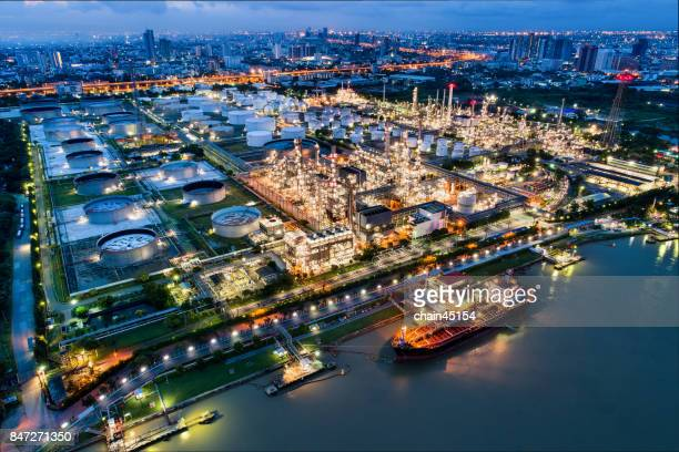 Oil refinery industry plant from aerial view in oil refinery industry or oil industrial. This oil refinery is in the city for refinery producing. Industrial concept.