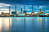 Oil refinery with reflection, petrochemical plant