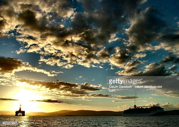 Oil Rig and cruise ship at sundown