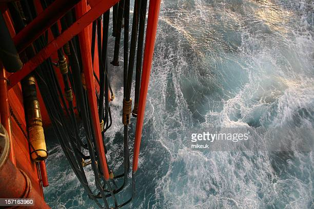 oil rig platform view down to sea and pontoon hoses