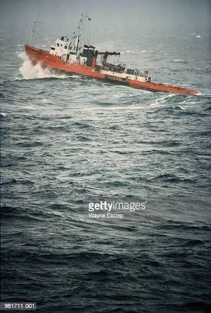 Oil rig rescue boat battling through rough seas