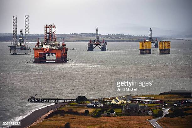 Oil rigs are left in the Cromarty Firth on February 2 2016 in Invergordon Scotland Rig platforms are being stacked up in the Cromarty Firth as oil...