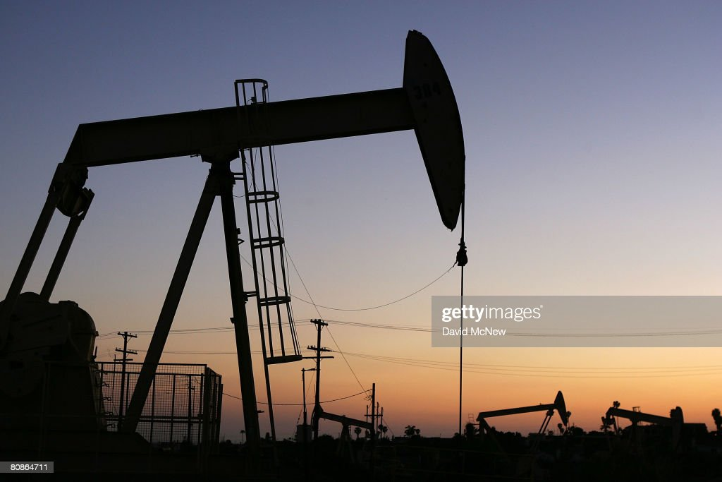 Oil rigs extract petroleum as the price of crude oil rises to nearly $120 per barrel prompting oil companies to reopen numerous wells across the...