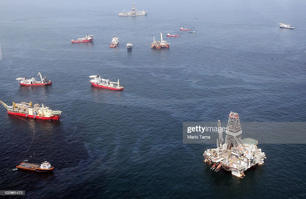 Oil sheen is seen with vessels assisting near the source of the BP Deepwater Horizon oil spill on July 18, 2010 in the Gulf of Mexico off the coast of Louisiana. Scientists are concerned about leakage spotted near BP's oil well which appeared to be sealed.