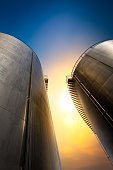 Storage tank for keep the oil on beautiful sunset background