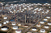 Oil storage tanks and refining facilities sit at the Esso oil refinery operated by Exxon Mobil Corp in Fawley UK on Friday Oct 2 2015 A 50 percent...