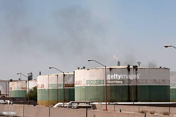 Oil storage tanks sit at the Petroleos Mexicanos Miguel Hidalgo oil refinery in Tula de Allende Mexico on Thursday March 25 2010 Pemex Latin...
