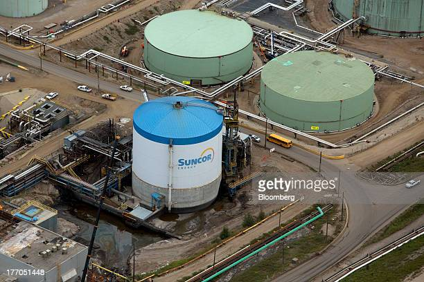 Oil storage tanks stand at a Suncor Energy Inc oil sands mining operation near Fort McMurray Alberta Canada on Tuesday Aug 13 2013 Canadian oil...