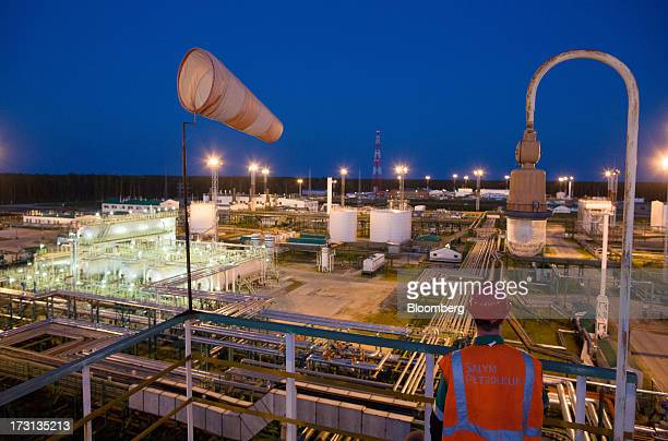 Oil storage tanks stand illuminated at night at an oil plant operated by Salym Petroleum in Salym KhantyMansi autonomous region Russia on Wednesday...