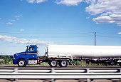 Oil tanker on road, side view