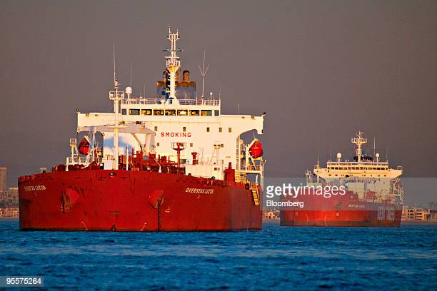 Oil tankers are anchored near the Port of Long Beach California US on Thursday Dec 31 2009 A surplus of idled oil tankers which would stretch 26...