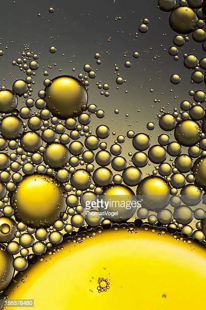 石油&ウォーター抽象的な背景のイエローゴールドの詳細