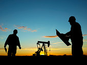 Oil Pump Pumpjack & Worker Silhouettes