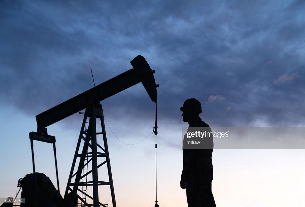 Oil Well Pumpjack & Worker Sillouhettes : Stock Photo