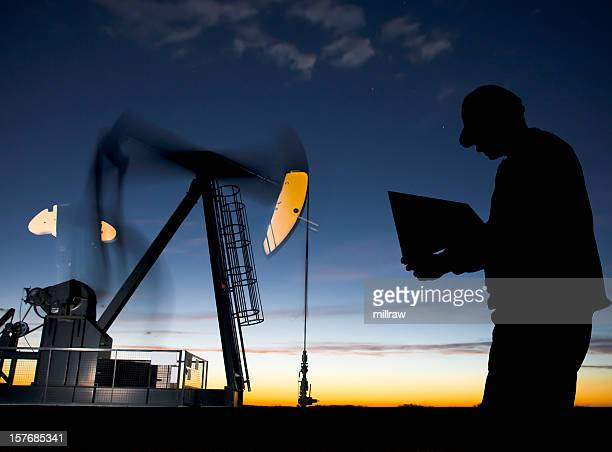 Oil Well Pumpjack at Dawn with Worker