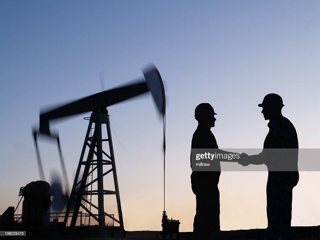 Oil Well Pumpjack in Motion With Workers : Stock Photo