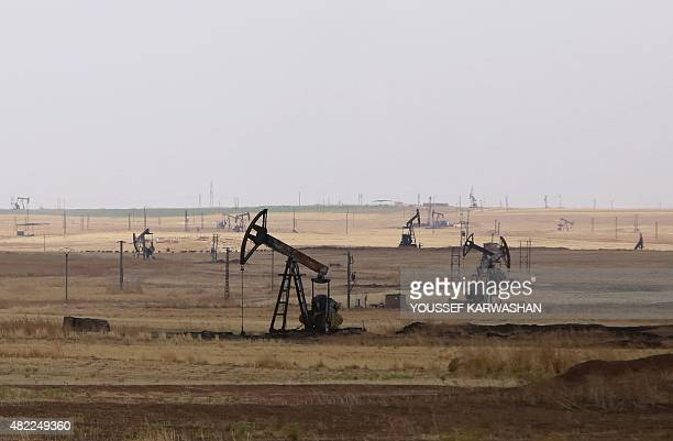 Oil well pumps are seen in the Rmeilane oil field in Syria's northerneastern Hasakeh province on July 15 2015 Rmeilane is one of the biggest oil...