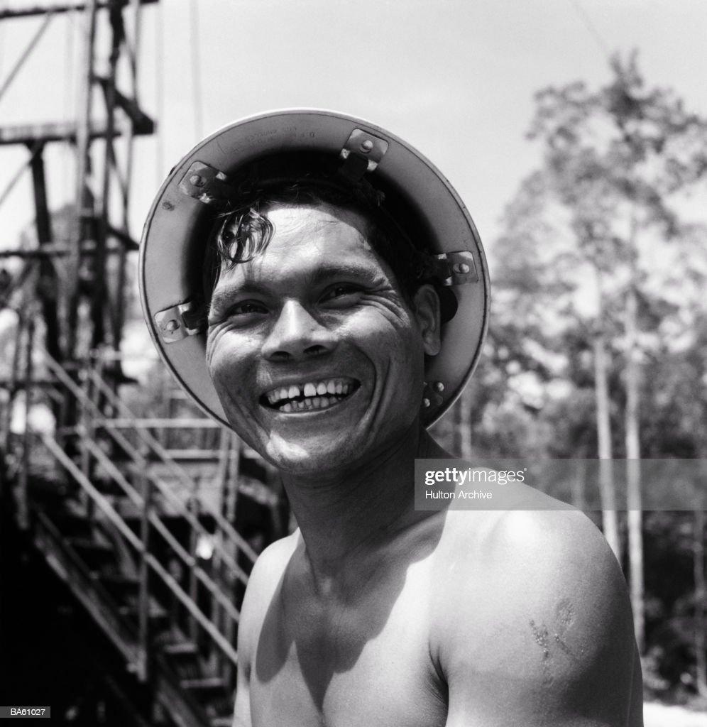 Oil well worker, portrait (B&W) : Stock Photo