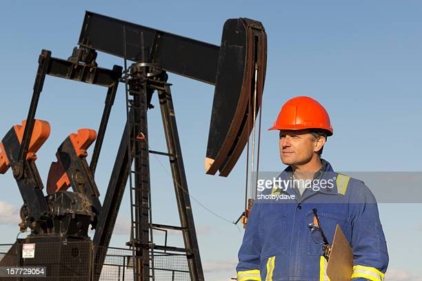 Oil Worker and Derrick