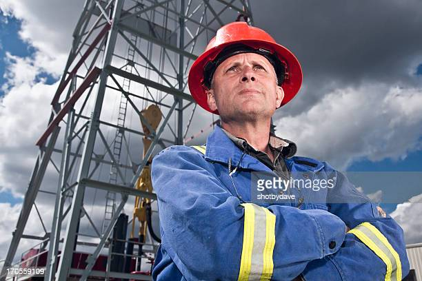 Oil Worker and Rig