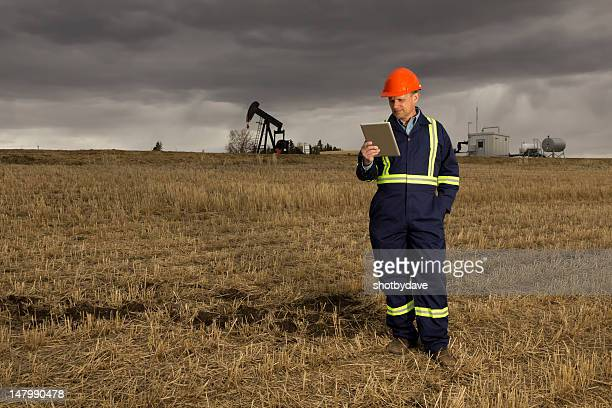 Oil Worker and Tablet