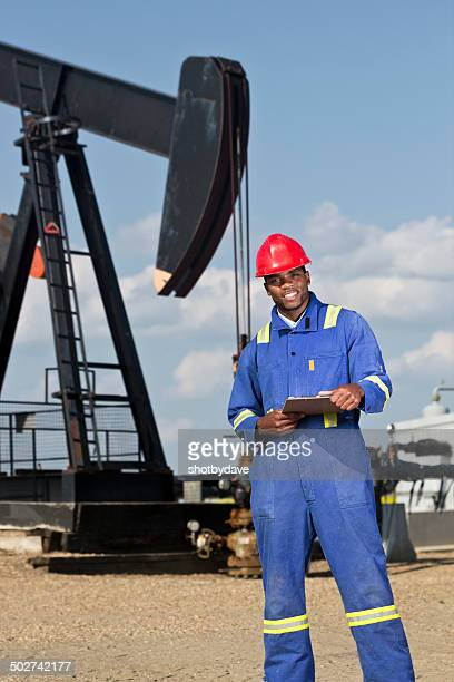 Oil Worker, Clipboard and Pumpjack