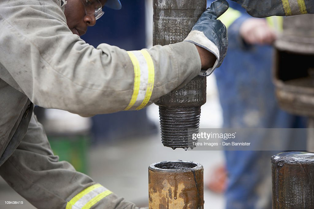 Oil worker drilling for oil on rig