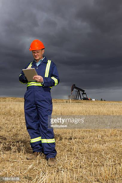 Oil Worker With a Tablet