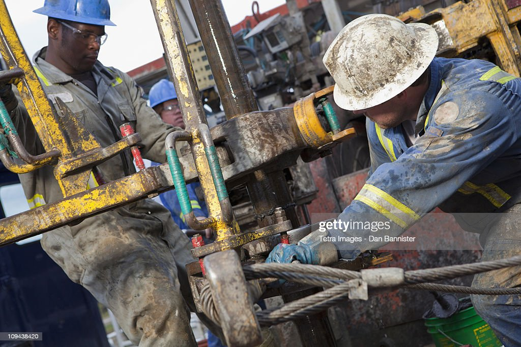 Oil workers drilling for oil on rig