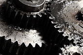 Oiled gears as small parts of large mechanism
