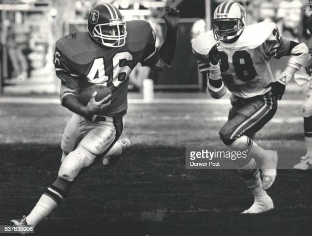 Oilers Emmuel Thompson in pirsuit of Broncos Bobby Micho in the 2nd quarter Credit The Denver Post
