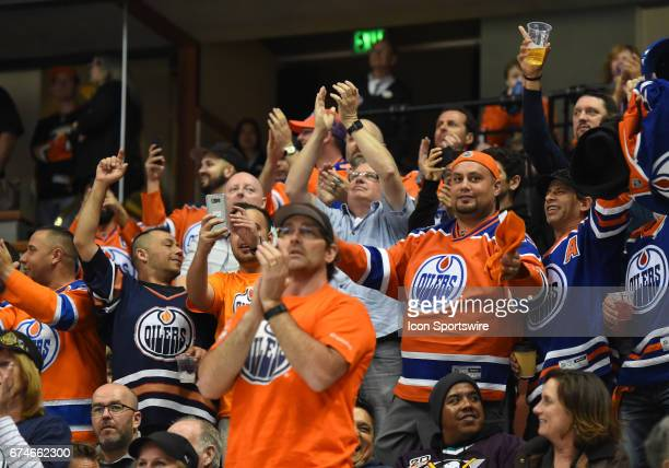 Oilers fans cheer on the team as the time expires on the clock during game 2 of the second round of the 2017 NHL Stanley Cup Playoffs between the...