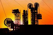 Oilfield derrick in the evening