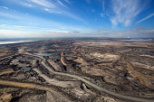 Expansive aerial view of a pit mining project in Alberta's Oilsands near Fort McMurray.