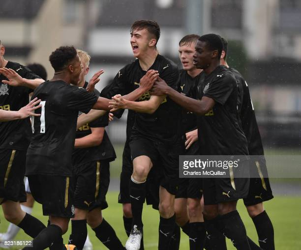 Oisin McEntee of Newcastle United celebrates with team mates after opening the scoring with a header during the Super Cup NI u18 tournament group...