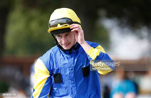 Oisin Murphy celebrates after riding Litigant to win The Betfred Ebor at York racecourse on August 22 2015 in York England