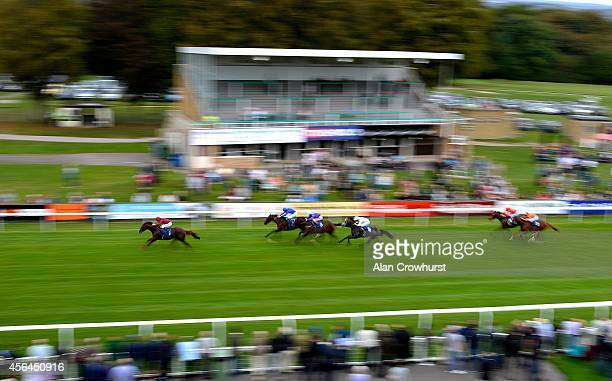 Oisin Murphy riding Chemical Charge win The Francis Clark British Stallion Studs EBF Maiden Stakes at Salisbury racecourse on October 01 2014 in...