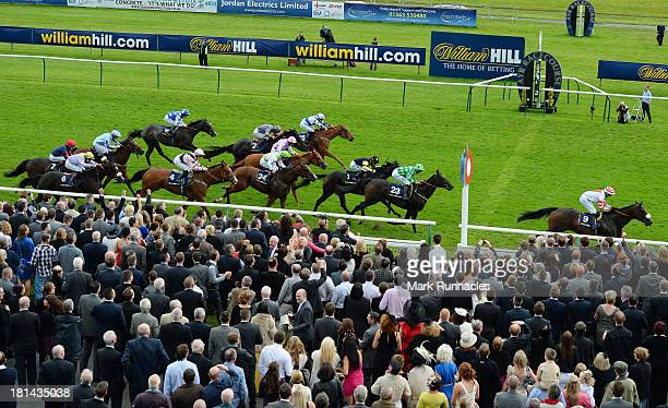Oisin Murphy riding Highland Colori winner of The William Hill Ayr Gold Cup at Ayr racecourse on September 21 2013 in Ayr Scotland
